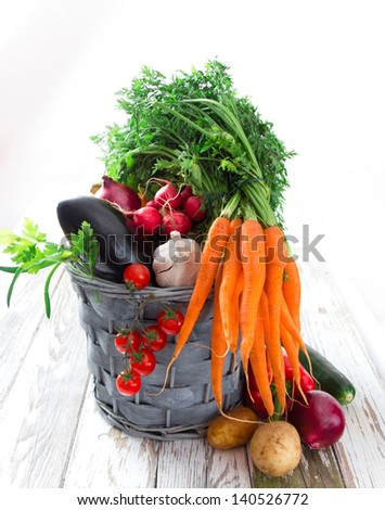Fresh vegetable on wooden background - stock photo