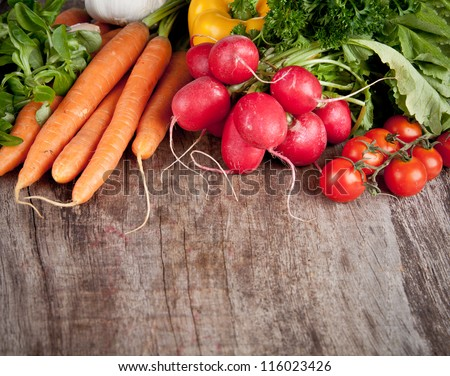 Fresh vegetable on wooden table - stock photo