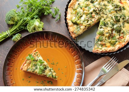 Fresh vegetable pie with broccoli, cheese and parsley - stock photo