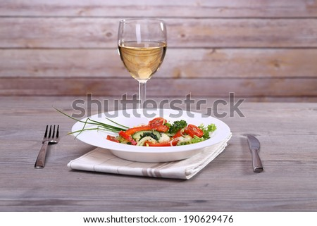 Fresh vegetable salad and white wine