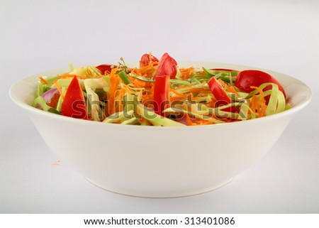 Fresh vegetable salad appetizer with cabbage,tomato ,carrots,cucumber, - stock photo