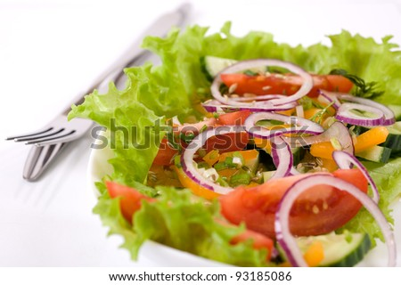 Fresh vegetable salad. Cucumber, tomatoes, peppers, onions and aromatic herbs