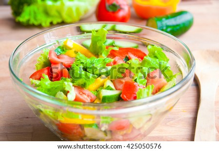 Fresh vegetable salad in a glass bowl