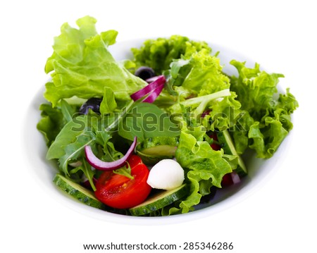 fresh vegetable salad in bowl isolated on white - stock photo