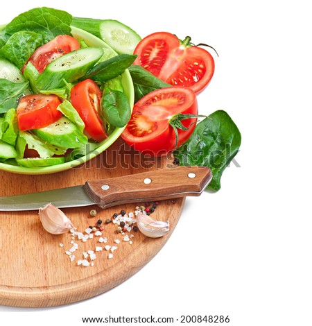 Fresh vegetable salad isolated on white - stock photo