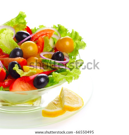 Fresh vegetable salad (tomato, peppers, cucumber, onion, olive) - stock photo