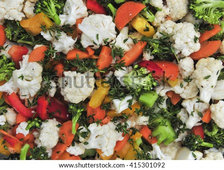 Fresh vegetable salad with cauliflower, broccoli, carrots and peppers, overhead view closeup - stock photo