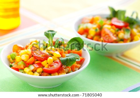 fresh vegetable salad with corn,carrot,tomato,cucumber and sweet pepper - stock photo