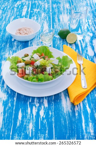 Fresh vegetable salad with feta cheese. Healthy food. Vegetable diet. Wooden board rustic - stock photo