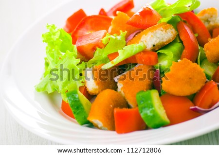 fresh vegetable salad with nuggets