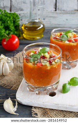 Fresh vegetable soup Gazpacho on the table. Fresh vegetables and herbs - stock photo