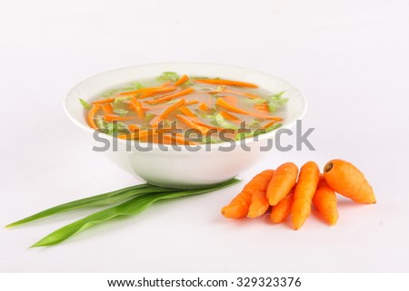Fresh vegetable soup made of , carrot, potato, red bell pepper, tomato and leek in bowl ,Selective focus photograph. - stock photo