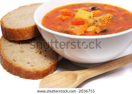 Fresh vegetable soup with bread - stock photo