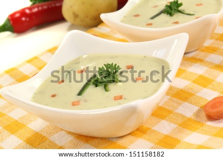 fresh vegetable soup with carrots on a light background - stock photo