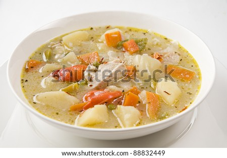 Fresh vegetable soup with chicken close up - stock photo
