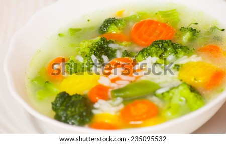Fresh vegetable soup with rice - stock photo