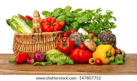 fresh vegetables and herbs on white background. Tomato, salad, basil, parsley, bell pepper - stock photo
