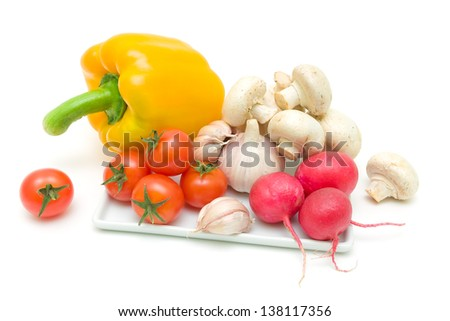 fresh vegetables and mushrooms isolated on a white background close-up