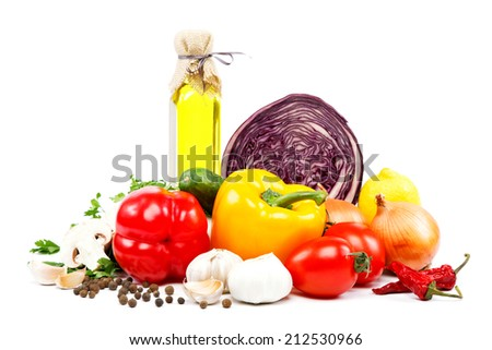 Fresh vegetables and olive oil isolated on a white background. - stock photo
