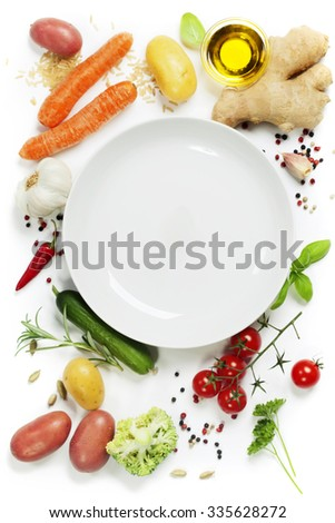 Fresh vegetables around empty white plate, top view, copy space - stock photo