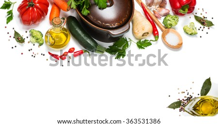 Fresh vegetables around pan for vegetarian dinner isolated on white background - stock photo