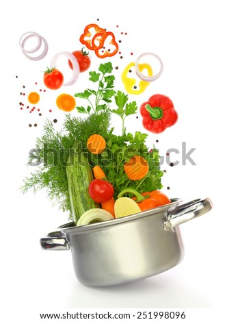 Fresh vegetables coming out of a cooking pot - stock photo