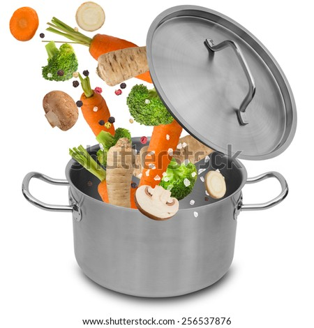 Fresh vegetables falling into stainless steel pot isolated on white background. - stock photo