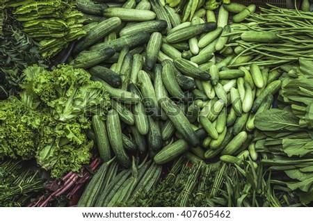 Fresh vegetables for sale on asian market. Pasar Siti Khadijah market, Malaysia - stock photo
