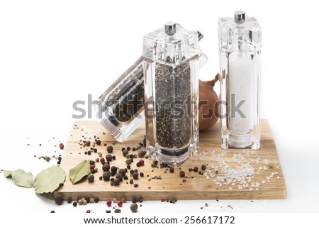 fresh vegetables, garlic and onions and glass mill with pepper and salt on a wooden Board, isolated on white background - stock photo