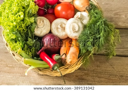 Fresh vegetables in a basket - stock photo