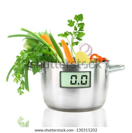 Fresh vegetables in a casserole pot with digital weight scale - stock photo