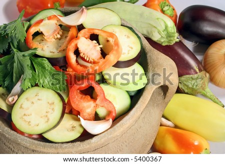 fresh vegetables in a clay pot - stock photo