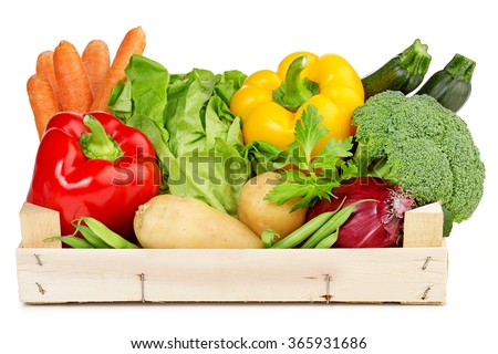 fresh vegetables in a wooden box isolated on white - stock photo