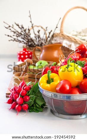 Fresh vegetables in basket on table kitchen - stock photo