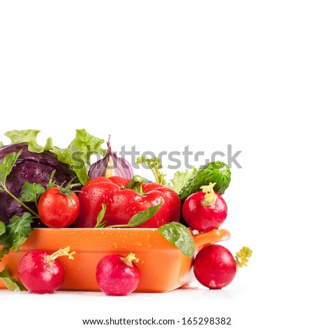 Fresh vegetables in bowl isolated on white background - stock photo
