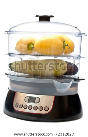 Fresh vegetables in electric steamer. Isolated on white