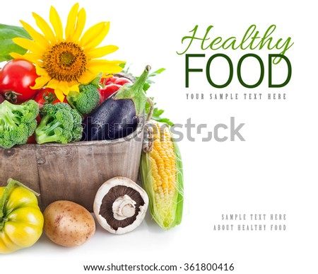 Fresh vegetables in wooden basket. Isolated on white background - stock photo