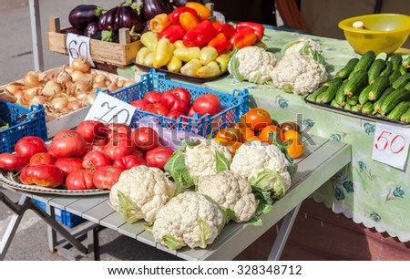 Fresh vegetables of new harvest ready to sale at the local farmers market - stock photo