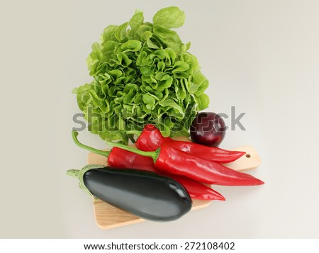 Fresh vegetables  on a chopping board - stock photo