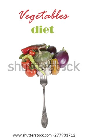 Fresh vegetables on a fork isolated on a white background. With an inscription vegetable diet - stock photo
