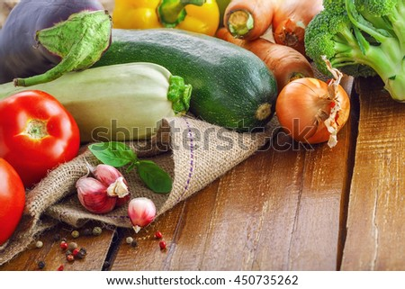 Fresh vegetables on a rustic wooden table. Organic ingredients for healthy food.