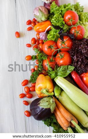 Fresh vegetables on a wooden background flat lay.