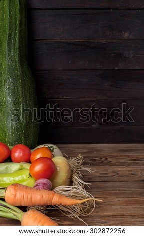 Fresh vegetables on a wooden table. Rustic style. Vegetarianism. Organic food. Space for text.