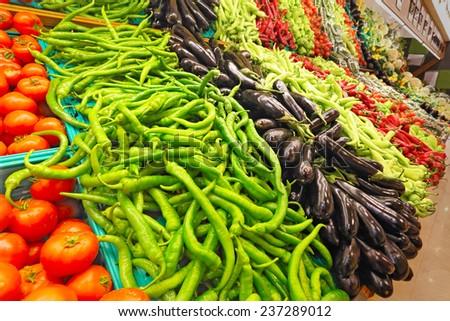 Fresh vegetables on shelf in supermarket - stock photo