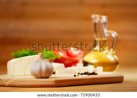 Fresh vegetables on the chopping board closeup - stock photo