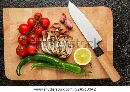 Fresh Vegetables On The Cutting Board And Knife : Garlic, Cherry Tomatoes,  Hot Pepper