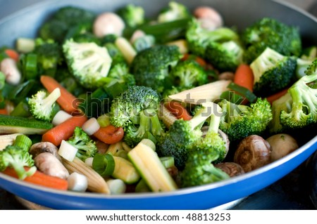 Fresh vegetables on the frying pan - stock photo