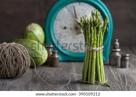 Fresh vegetables on the old vintage scales on wooden background - stock photo