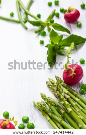 Fresh vegetables on the white wooden table - stock photo