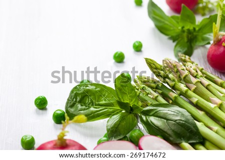 Fresh vegetables on the white wooden table. - stock photo